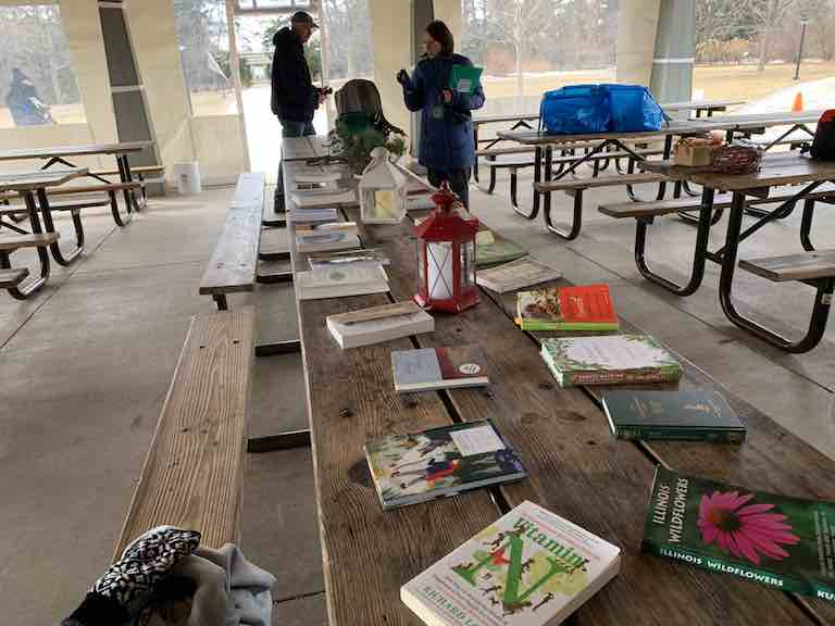 Forest bathing - outdoor shelter with table of books about forest bathing