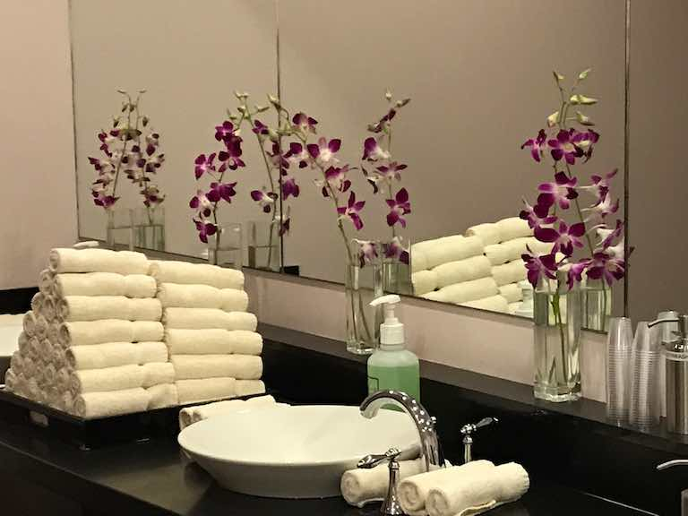 Massage spa dressing room with orchids and towels